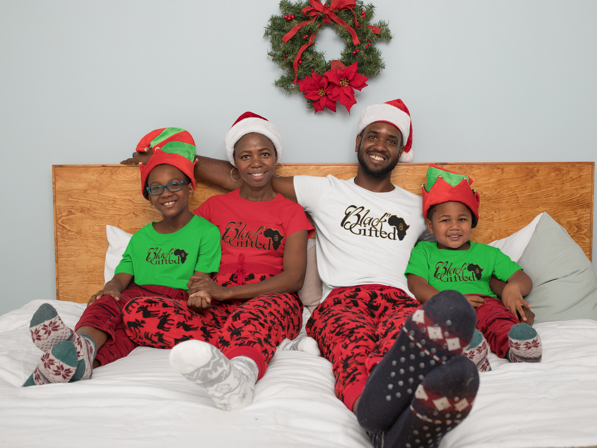 x-mas-mockup-of-a-family-with-matching-t-shirts-in-the-bedroom-30360.png